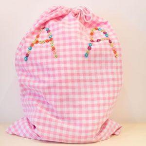 Pink gingham laundry bag
