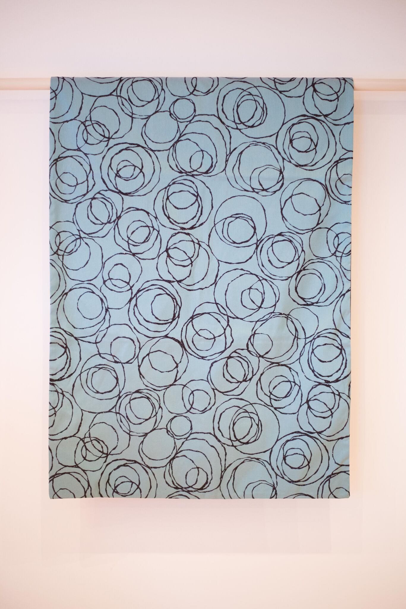 Blue and black bed runner