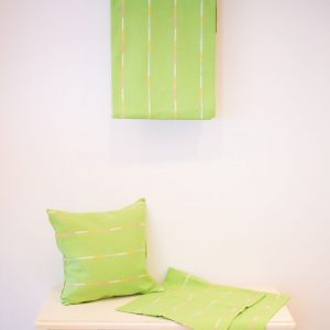 Green striped bedspread and cushions
