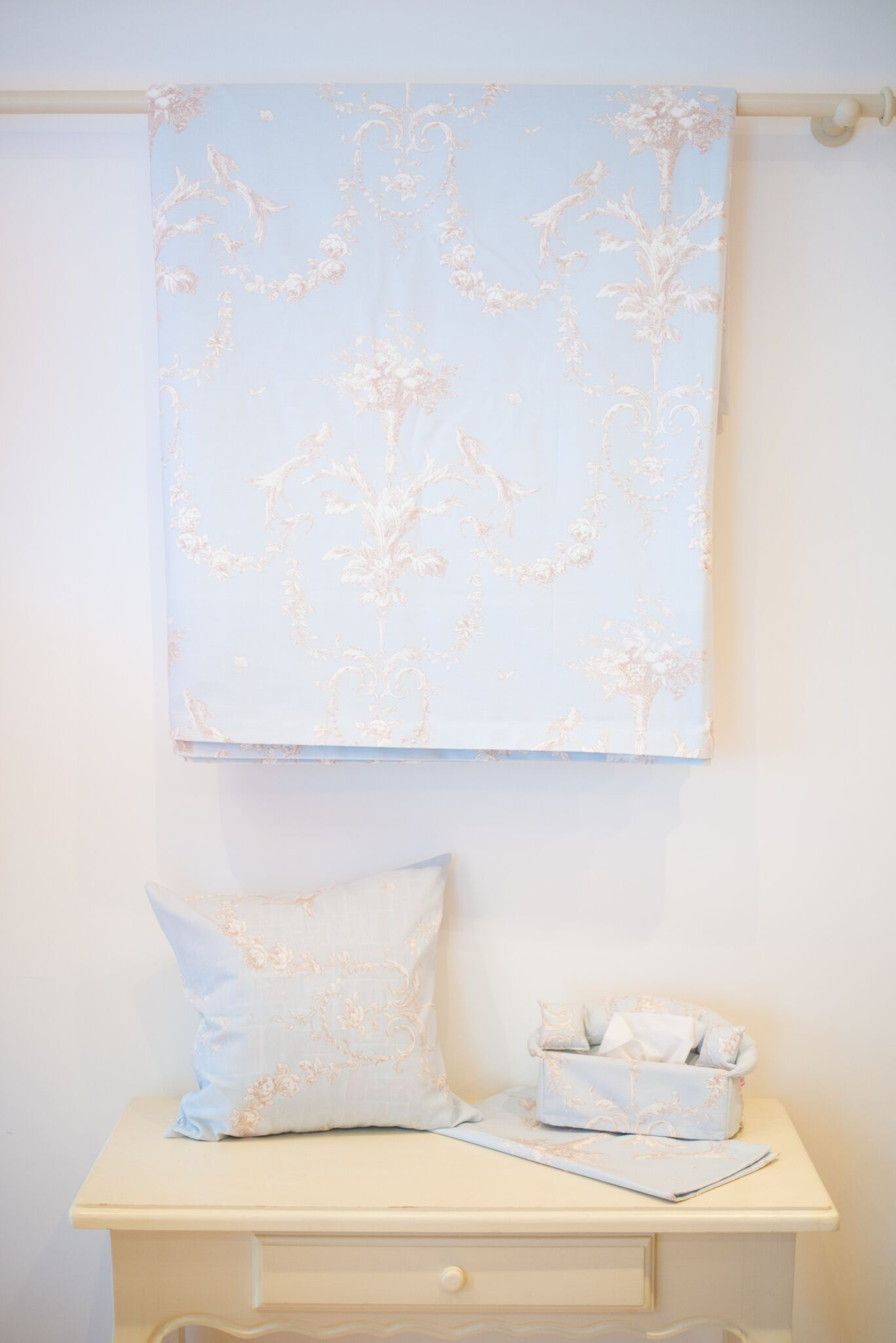 Pale blue floral bedspread and cushions